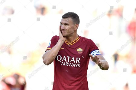 AS Roma's Edin Dzeko reacts during the Italian Seria A soccer match between AS Roma and Cagliari Calcio at Olimpico stadium in Rome, Italy, 06 October 2019.