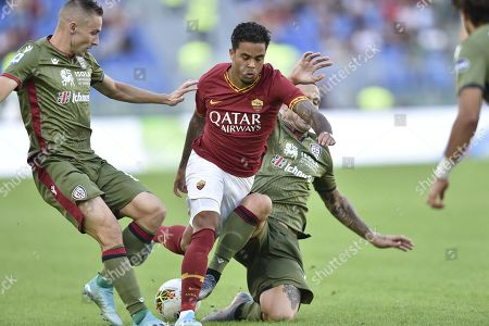 AS Roma Justin Kluivert (C) vies for the ball with Cagliari Radja Nainggolan (R) during the Italian Serie A soccer match between AS Roma and Cagliari Calcio at Olimpico stadium in Rome, Italy, 06 October 2019.