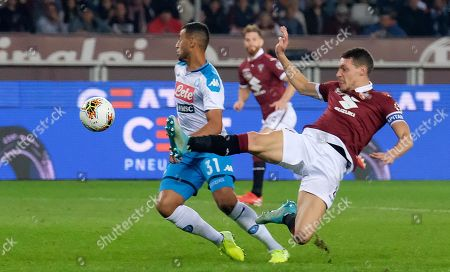 Torinos Andrea Belotti (R) and Napolis Faouzi Ghoulam in action during the Italian Serie A soccer match Torino FC vs SSC Napoli at Grande Torino Olimpico stadium in Turin, Italy, 6 October 2019.