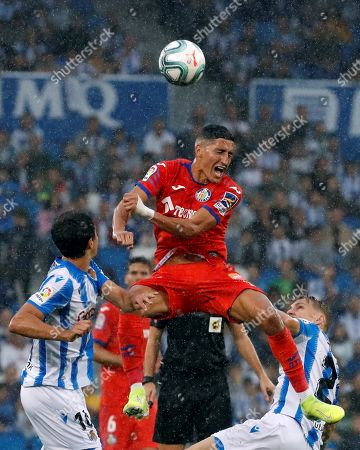 Getafe's Faycal Fajr (C) in action during a Spanish LaLiga soccer match between Real Sociedad and Getafe at the Anoeta stadium in San Sebastian, Basque Country, northern Spain, 06 October 2019.