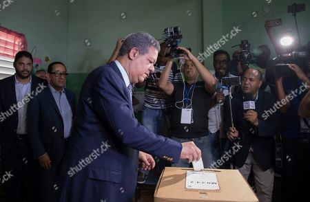Dominican Republic Primaries. Leonel Fernandez, a former president of the Dominican Republic who is running for the presidential nomination with the political party Partido de la Liberacion Dominicana, votes during the primary election in Santo Domingo, Dominican Republic