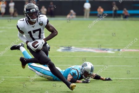 Jacksonville Jaguars wide receiver D.J. Chark (17) runs for a touchdown while Carolina Panthers defensive back Ross Cockrell (47) misses the tackle during the first half of an NFL football game in Charlotte, N.C