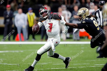 Tampa Bay Buccaneers quarterback Jameis Winston (3) scrambles under pressure from New Orleans Saints defensive end Cameron Jordan in the first half of an NFL football game in New Orleans