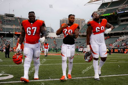 Cincinnati Bengals offensive guard John Miller (67), running back Joe Mixon (28), and offensive tackle Bobby Hart (68) walk off the field after losing an NFL football game against the Arizona Cardinals, in Cincinnati