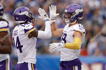 Minnesota Vikings wide receiver Adam Thielen (19) and Minnesota Vikings wide receiver Stefon Diggs (14) celebrate after a touchdown against the New York Giants during the third quarter of an NFL football game, in East Rutherford, N.J