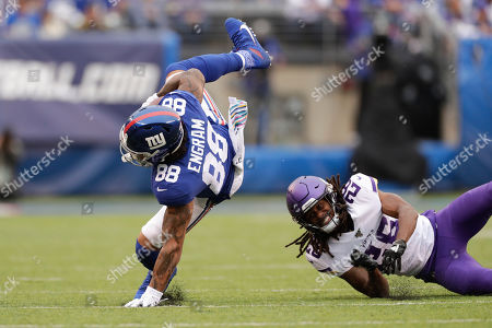 New York Giants tight end Evan Engram (88) is upended by Minnesota Vikings cornerback Trae Waynes (26) during the first quarter of an NFL football game, in East Rutherford, N.J
