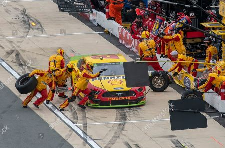 Joey Logano (22) pits during the Drydene 400 NASCAR Cup Series auto race, at Dover International Speedway in Dover, Del
