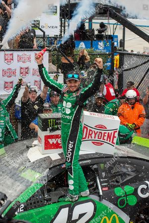 Kyle Larson celebrates his win in the NASCAR Cup Series auto race, at Dover International Speedway in Dover, Del