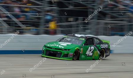 Kyle Larson drives on the way to winning the NASCAR Cup Series playoff auto race, at Dover International Speedway in Dover, Del