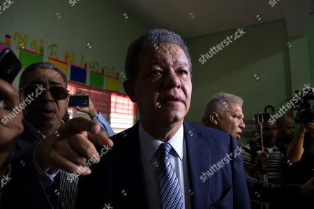 Dominican Republic Primaries. Leonel Fernandez, a former president of the Dominican Republic who is running for the presidential nomination with the political party Partido de la Liberacion Dominicana, speaks to the press after voting during primary elections in Santo Domingo, Dominican Republic