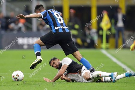Juventus' Emre Can, bottom, fights for the ball with Inter Milan's Matias Vecino during a Serie A soccer match between Inter Milan and Juventus, at the San Siro stadium in Milan, Italy
