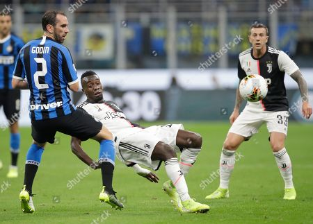 Inter Milan's Diego Godin, left, fights for the ball with Juventus' Blaise Matuidi during a Serie A soccer match between Inter Milan and Juventus, at the San Siro stadium in Milan, Italy