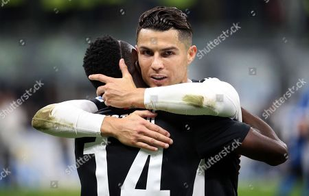 Juventus' Cristiano Ronaldo hugs his teammate Blaise Matuidi (L) during the Italian serie A soccer match between FC Inter and Juventus FC at Giuseppe Meazza stadium in Milan, Italy, 6 October 2019.