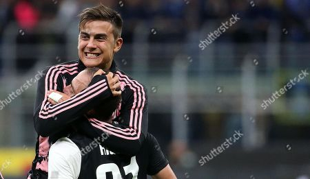 Juventus' Gonzalo Higuain celebrates with his teammate Paulo Dybala (back)  during the Italian serie A soccer match between FC Inter and Juventus FC at Giuseppe Meazza stadium in Milan, Italy, 6 October 2019.