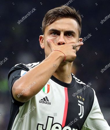 Juventus' Paulo Dybala jubilates after scoring the 0-1 goal during the Italian serie A soccer match between FC Inter and Juventus FC at Giuseppe Meazza stadium in Milan, Italy, 6 October 2019.