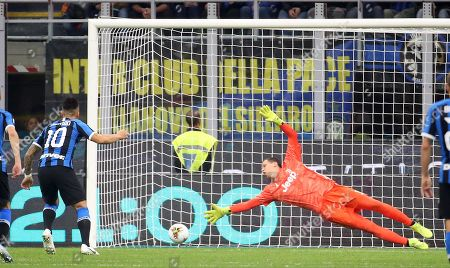 Inter's Lautaro Martinez (L) scores on penalty against Juventus' goalkeeper Wojciech Szczesny the 1-1 goal during the Italian serie A soccer match between FC Inter and Juventus FC at Giuseppe Meazza stadium in Milan, Italy, 6 October 2019.
