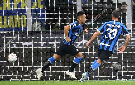 Inter's Lautaro Martinez (L)  jubilates with his teammate Danilo D'Ambrosio after scoring the 1-1 during the Italian serie A soccer match between FC Inter and Juventus FC at Giuseppe Meazza stadium in Milan, Italy, 6 October 2019.