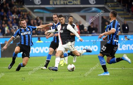 Juventus' Cristiano Ronaldo  (C) scores (but the goal is disallowed by referee Gianluca Rocchi due to an offside position before of Paulo Dybala, not pictured) during the Italian serie A soccer match between FC Inter and Juventus FC at Giuseppe Meazza stadium in Milan, Italy, 6 October 2019.