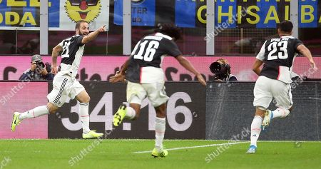 Juventus' Gonzalo Higuain (L) celebrates with his teammates Juan Cuadrado (C) and Emre Can after scoring the 1-2 goal during the Italian serie A soccer match between FC Inter and Juventus FC at Giuseppe Meazza stadium in Milan, Italy, 6 October 2019.