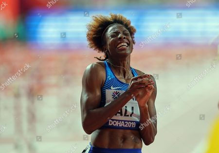Nia Ali of United States winning in the 100 meter hurdles for women during the 17th IAAF World Athletics Championships at the Khalifa Stadium in Doha, Qatar