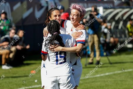 United States forward Carli Lloyd, center back, celebrates with defender Crystal Dunn, front, and forward Megan Rapinoe, right, after scoring against the South Korea during the first half of an international friendly soccer match, in Chicago