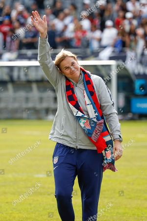 United States head coach Jill Ellis waves to the crowd as she leaves the field after an international friendly soccer match between the United States and South Korea, in Chicago