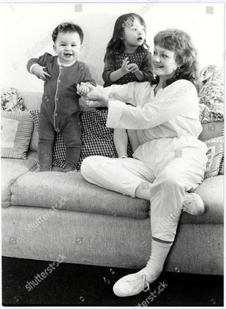 Stock Photo of Gina Rowe Wife Of Actor Art Malik With Their Two Children Jessica (nearly Three) And Keira (nearly1 ) At Their Surrey Home.