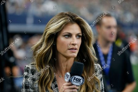Stock Photo of FOX Sports sideline reporter Erin Andrews works on the sideline in the first half of an NFL football game between the Green Bay Packers and Dallas Cowboys in Arlington, Texas