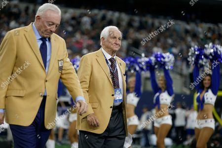 Gil Brandt, Jerry Jones. Dallas Cowboys team owner Jerry Jones, left, and Hall Of Fame inductee Gil Brandt, right, participate in a ceremony at half time of an NFL football game against the Green Bay Packers in Arlington, Texas, . Jones presents Brandt with his HOF ring in the ceremony