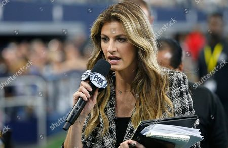 FOX Sports reporter Erin Andrews works the sidelines as the Cowboys play the Green Bay Packers in the first half of an NFL football game in Arlington, Texas