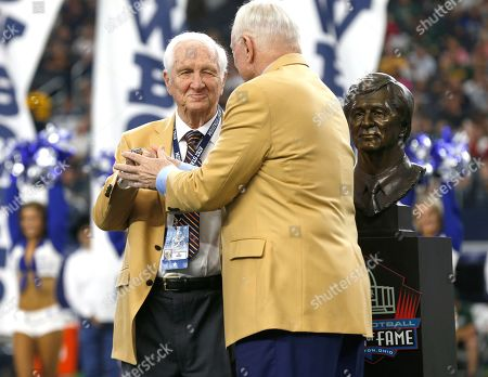 Gil Brandt; Jerry Jones. Hall Of Fame inductee Gil Brandt, left, is presented with his HOF ring by Dallas Cowboys team owner Jerry Jones, right, during a half time ceremony during an NFL football game against the Green Bay Packers in Arlington, Texas
