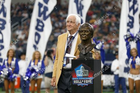Hall Of Fame inductee Gil Brandt, left, looks on after being presented with his HOF ring by Dallas Cowboys team owner Jerry Jones during a half time ceremony during an NFL football game against the Green Bay Packers in Arlington, Texas