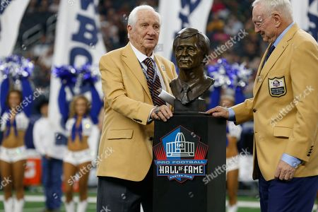 Stock Picture of Gil Brandt; Jerry Jones. Hall Of Fame inductee Gil Brandt, left, is presented with his HOF ring by Dallas Cowboys team owner Jerry Jones, right, during a half time ceremony during an NFL football game against the Green Bay Packers in Arlington, Texas