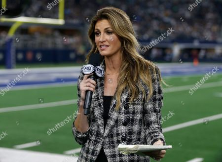 FOX Sports sideline reporter Erin Andrews updates from the field during an NFL football game between the Green Bay Packers and Dallas Cowboys in Arlington, Texas