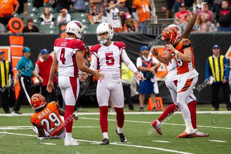 Zane Gonzalez (5) of the Arizona Cardinals celebrates with Andy Lee (4) of the Arizona Cardinals after kicking the game winning field goal of an NFL football game between the Arizona Cardinals and the Cincinnati Bengals at Paul Brown Stadium on , in Cincinnati, OH