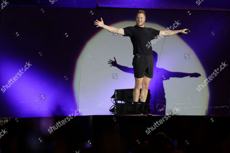 Stock Image of Dan Reynolds of the band Imagine Dragons performs at the Rock in Rio music festival in Rio de Janeiro, Brazil