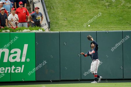 Atlanta Braves center fielder Ronald Acuna Jr. catches a fly ball hit by St. Louis Cardinals' Paul Goldschmidt during the first inning in Game 3 of a National League Division Series, in St. Louis