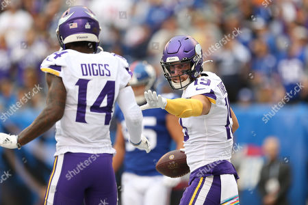 Minnesota Vikings wide receiver Adam Thielen (19) and wide receiver Stefon Diggs (14) celebrate after scoring a touchdown during an NFL football game, in East Rutherford, N.J