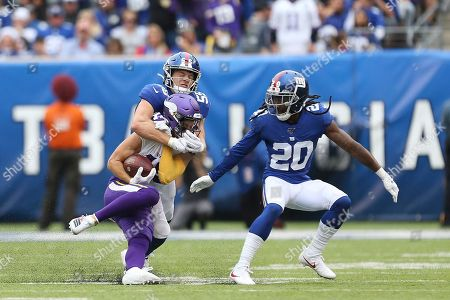 New York Giants outside linebacker David Mayo (55) tackles Minnesota Vikings wide receiver Adam Thielen (19) as New York Giants cornerback Janoris Jenkins (20) looks on during an NFL football game, in East Rutherford, N.J. The Giants lost 28-10