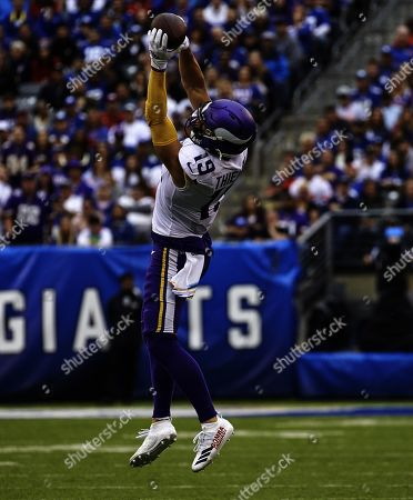 , 2019, East Rutherford, New Jersey, USA: Minnesota Vikings wide receiver Adam Thielen (19) catches a pass in the first half during a NFL game between the Minnesota Vikings and the New York Giants at MetLife Stadium in East Rutherford, New Jersey