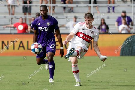 Bastian Schweinsteiger, Kamal Miller. Chicago Fire's Bastian Schweinsteiger, right, passes the ball in front of Orlando City's Kamal Miller (27) during the first half of an MLS soccer match, in Orlando, Fla