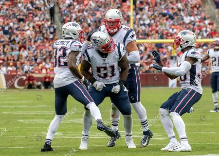 New England Patriots linebacker Ja'Whaun Bentley (51) celebrates with teammates free safety Devin McCourty (32), middle linebacker Kyle Van Noy (53) and cornerback Jason McCourty (30) following his hard tackle of Washington Redskins running back Chris Thompson (25) in the fourth quarter of the game. The Patriots won the game 33 - 7.