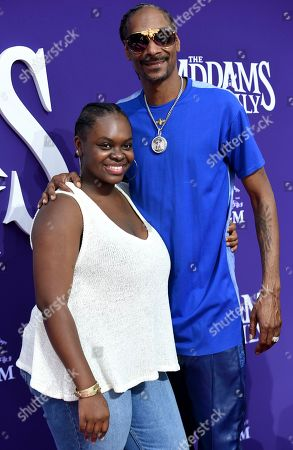"Cori Broadus, Snoop Dogg. Cast member Snoop Dogg, right, and his daughter Cori Broadus arrive at the Los Angeles premiere of ""The Addams Family"" at Westfield Century City on"