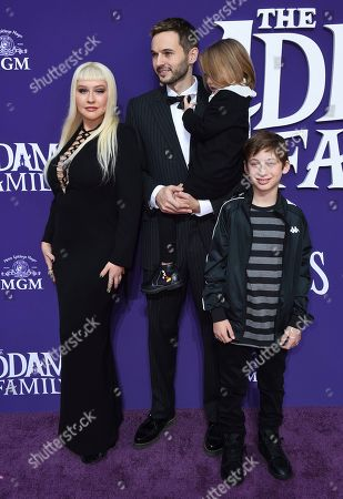 """Stock Image of Christina Aguilera, Max Bratman, Summer Rain Rutler, Matthew Rutler. Christina Aguilera arrives with, from left, her husband Matthew Rutler, Summer Rain Rutler and Max Bratman at the Los Angeles premiere of """"The Addams Family"""" at Westfield Century City on"""