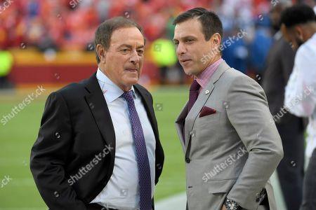 Stock Image of Broadcaster Al Michaels with NBC Sports, left, talks to Brett Veach, general manager of the Kansas City Chiefs, before an NFL football game against the Indianapolis Colts in Kansas City, Mo