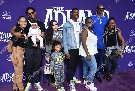 """Snoop Dogg poses with his family at the Los Angeles premiere of """"The Addams Family"""" at Westfield Century City on"""