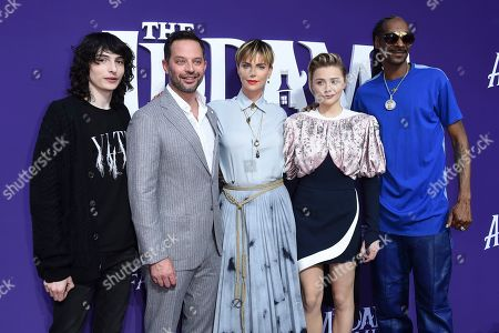 "Finn Wolfhard, Nick Kroll, Charlize Theron, Chloe Grace Moretz, Snoop Dogg. From left, cast members Finn Wolfhard, Nick Kroll, Charlize Theron, Chloe Grace Moretz and Snoop Dogg arrive at the Los Angeles premiere of ""The Addams Family"" at Westfield Century City on"