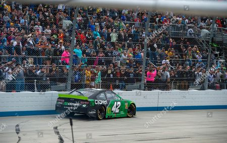 Stock Image of Kyle Larson No.tops for the fans after winning the NASCAR Cup Series playoff auto race, at Dover International Speedway in Dover, Del
