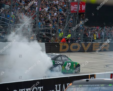 Stock Picture of Kyle Larson No. (42) does a burn out after winning the Drydene 400 - Monster Energy NASCAR Cup Series playoff auto race, at Dover International Speedway in Dover, Del