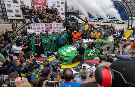 Kyle Larson drives into Victory Lane after winning the NASCAR Cup Series playoff auto race, at Dover International Speedway in Dover, Del